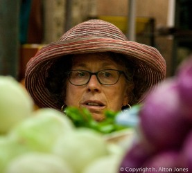 A head of luttuce, a pile of onions and a head of Liz